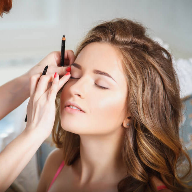 Woman having makeup professionally done