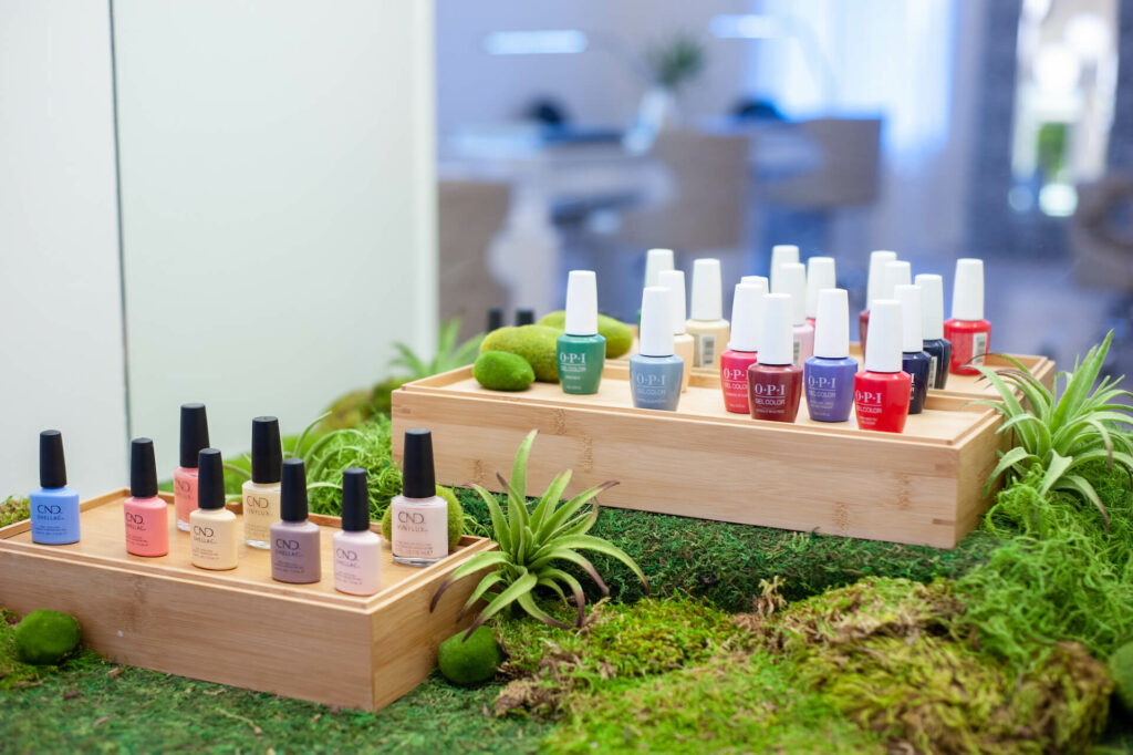 Many bottles of different colored nail polish